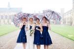 026-AlexBeckett-bridesmaids-in-snow-on-wedding-day-at-Trinity-college-Cambridge